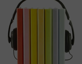 Row of coloured books with headphones